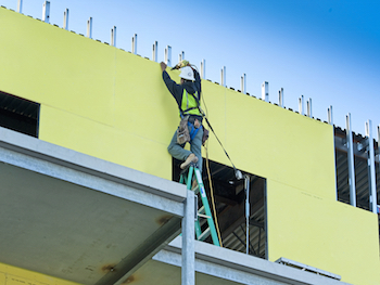 Construction worker performing commercial building rennovation